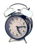 Alarm clock on white background. Ready to ring Stock Photo