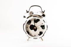 Alarm clock on white background. White alarm clock with black stains on white background Royalty Free Stock Image