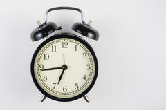 Alarm clock on a white background, to right place for an inscription Royalty Free Stock Images