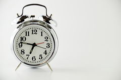 Alarm Clock on White Backround. A Two Bell wind up alarm clock on a plain white background Royalty Free Stock Image