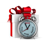 Alarm clock and white gift box. Isolated 3D illustration.  Royalty Free Stock Photography