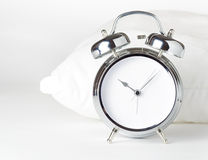 Alarm clock and white pillow Stock Photography