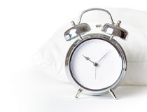 Alarm clock and white pillow.  Stock Images