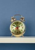 Alarm clock on white shelf Royalty Free Stock Photo