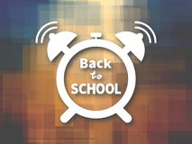 Alarm clock white silhouette with Back to school text over multicolored background Stock Image