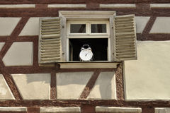 The alarm-clock on the window Stock Photography