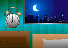Alarm clock at the window beside the bed in the evening. Stock Photo