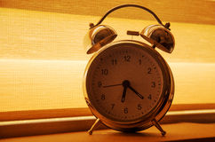 Alarm clock on window sill. In the morning Stock Images