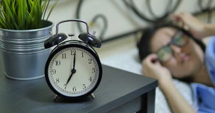Alarm clock with woman on the bed stock footage