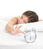 Alarm Clock woman waking up late in bed Royalty Free Stock Photo