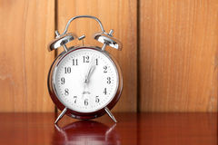 Alarm clock. On wood background Stock Image