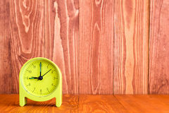 Alarm clock on the wood background Stock Images