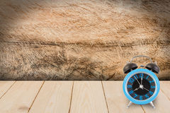 Alarm clock on wood texture. Royalty Free Stock Photos
