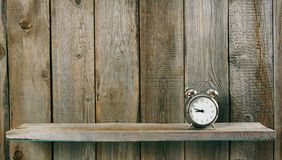 Alarm clock. On wooden background. Royalty Free Stock Photo