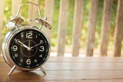 Alarm Clock On Wooden Background Stock Photo