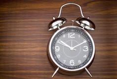 Alarm Clock On Wooden Background Stock Photos