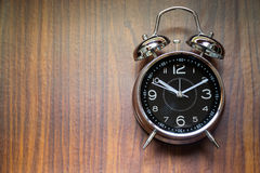 Alarm Clock On Wooden Background Stock Images