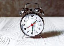 Alarm clock on wooden shelf Royalty Free Stock Photo