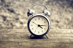 Alarm clock on wooden surface Royalty Free Stock Photos