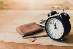 Alarm clock on wooden table Stock Photo