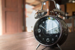 Alarm Clock On Wooden Work Table Royalty Free Stock Photo