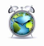 Alarm clock world. Alarm clock with the world inside Stock Photos