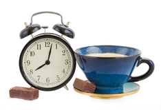 Alarm clock wuth cup of coffee stock photo