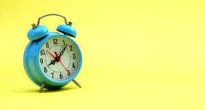 Alarm clock on yellow Stock Images