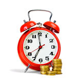 Alarm clock and yellow coins Royalty Free Stock Image
