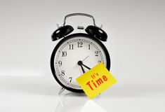Alarm clock with a yellow note Royalty Free Stock Image