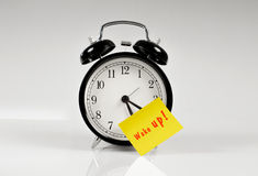 Alarm clock with a yellow note Stock Photography