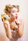 Alarm clock & young blond pinup green eyes woman l. Portrait of happy young blond pinup green eyes woman with alarm-clock looking at camera & showing silence Royalty Free Stock Photo