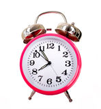 Alarm Clocks. Several brightly colored traditional alarm clocks thrown on a white background royalty free stock photos
