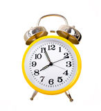 Alarm Clocks. Several brightly colored traditional alarm clocks thrown on a white background stock photography