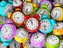 Alarm clocks background. 3D illustration. Multi-colored alarm clocks stack background. 3D illustration Royalty Free Stock Image