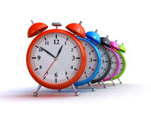 Alarm clocks. Colorful alarm clocks on the white background (3d render Royalty Free Stock Photography