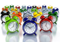 Alarm Clocks. 3d Illustration of multicolored alarm clocks on a white back stock photo
