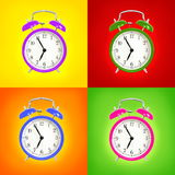 Alarm clocks isolated on colorful background Royalty Free Stock Image