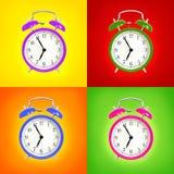 Alarm clocks isolated on colorful background Royalty Free Stock Image
