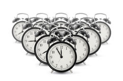 Alarm clocks. Many black old style alarm clocks stock images