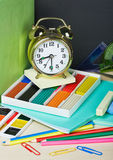 Alarm clocks and school supplies Royalty Free Stock Images