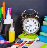Alarm clocks and school supplies Royalty Free Stock Image
