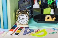 Alarm clocks and school supplies Royalty Free Stock Image