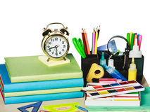 Alarm clocks and school supplies isolated Royalty Free Stock Image