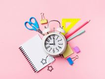 Alarm with supplies. Back to school theme stock photography