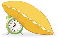 Alarm covered with pillow Royalty Free Stock Photography