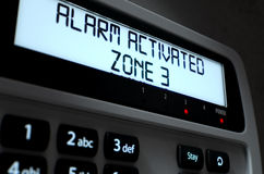 Alarm Panel Activated. A 3D render of a home security keypad access panel with buttons and an illuminated screen displaying a break in or security breach Stock Image