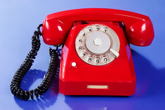 Alarm phone. Extremly red old-fashion telephone Royalty Free Stock Photography