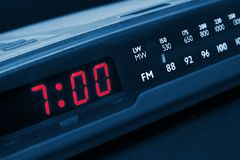 Alarm radio clock. Time to wake up. Alarm radio clock indicating time to wake up Royalty Free Stock Image