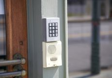 Alarm Security Keypad and Call Box. An alarm security keypad and call box installed outside of a residential home royalty free stock photo